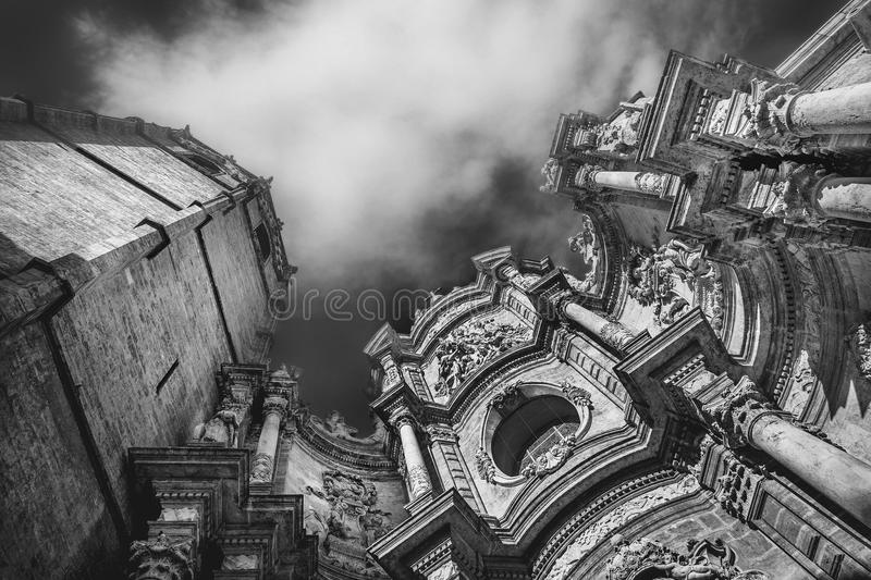 Basilica of the Assumption of Our Lady of Valencia, Spain. Dramatic scene with clouds and facade of Metropolitan Cathedral–Basilica of the Assumption of royalty free stock photography