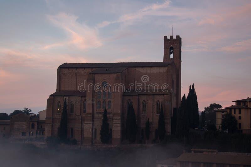 Basilica Cateriniana or Basilica of San Domenico in the mist, Siena, Tuscany, Italy. royalty free stock image