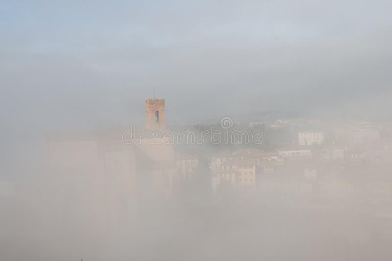 Basilica Cateriniana or Basilica of San Domenico in the thick fog, Siena, Tuscany, Italy. stock photo