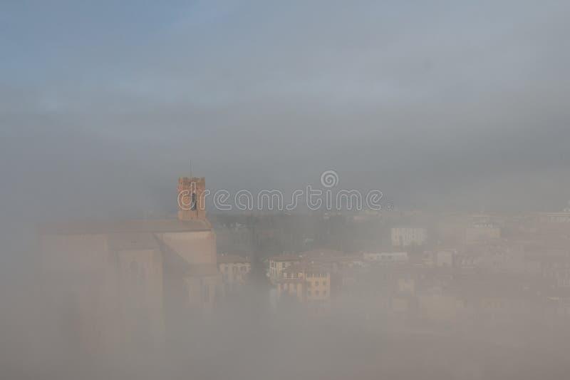 Basilica Cateriniana or Basilica of San Domenico in the thick fog, Siena, Tuscany, Italy. royalty free stock image