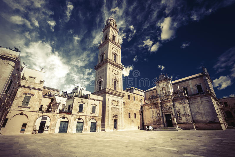 Basilica Church of the Holy Cross. Lecce, Italy. Square of the famous basilica Church of the Holy Cross. Historic city of Lecce, Italy. Blue sky with some clouds royalty free stock photos