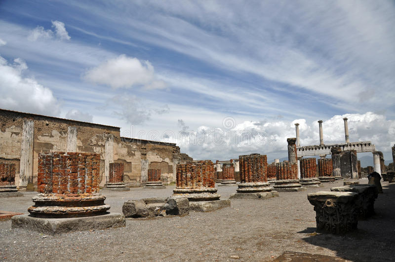 Basilica in destroyed Pompeii. The ruins of basilica in destroyed Pompeii royalty free stock photo