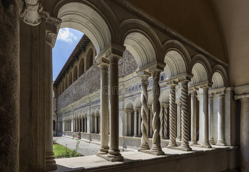 Basilica di San Giovanni in Laterano & x28;St. John Lateran basilica& x29;. Inner patio surrounded by graceful twisted columns of inlaid marble. Italy, Rome royalty free stock image