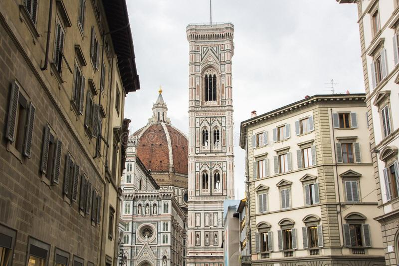 Basilica di Santa Maria del Fiore with Giotto campanile tower bell and Baptistery of San Giovanni. View from street of Florence, stock image