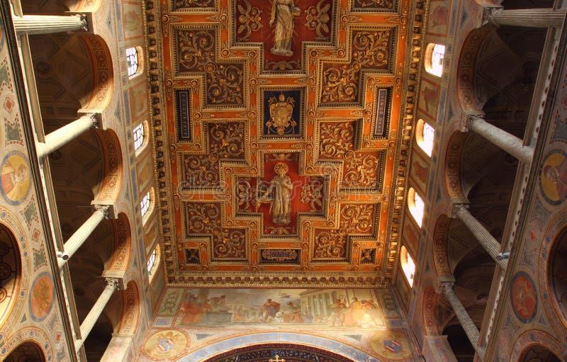 Basilica di SantAgnese fuori le mura. ROME, ITALY - JUNE 28, 2015: the rich wooden ornated ceiling in the Basilica di Sant Agnese fuori le mura stock image