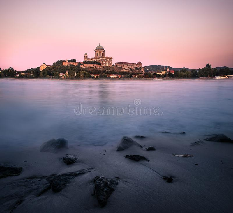 Basilica of Esztergom. Basilica of Esztergom with Danube at sunset and lovely washed shore royalty free stock photos