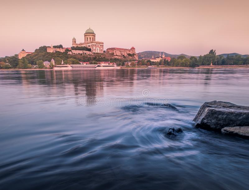 Basilica of Esztergom III. Basilica of Esztergom with Danube at sunset and interesting water royalty free stock images