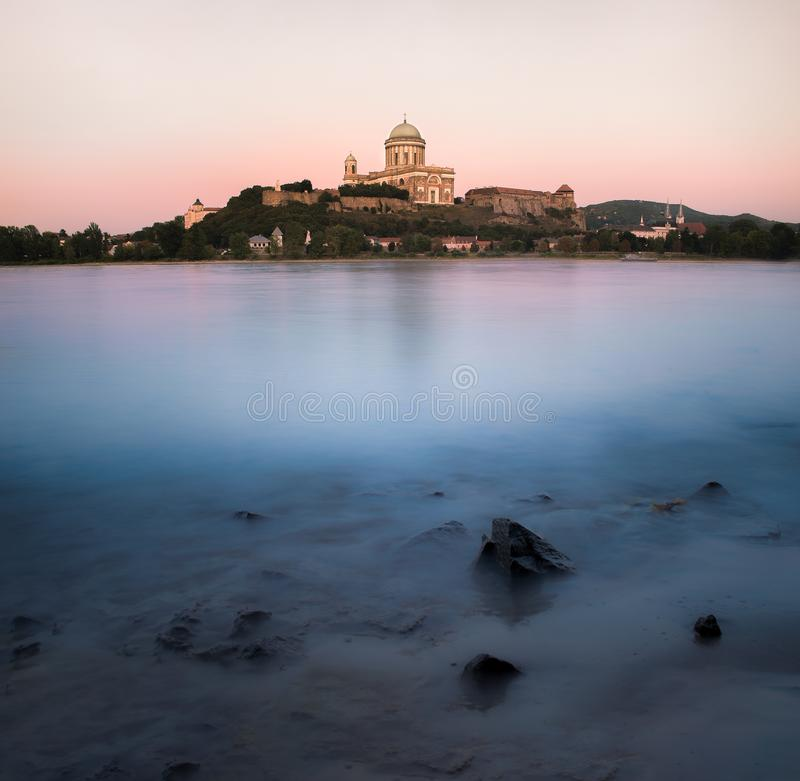 Basilica of Esztergom II. Basilica of Esztergom with Danube at sunset and lovely washed shore royalty free stock images