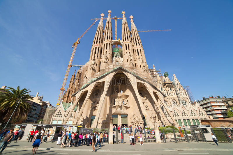 Basilica and Expiatory Church of Holy Family. BARCELONA, SPAIN - APRIL 12: Tourists looking Sagrada Familia in April 12, 2011 in Barcelona, Spain. Basilica and royalty free stock photography