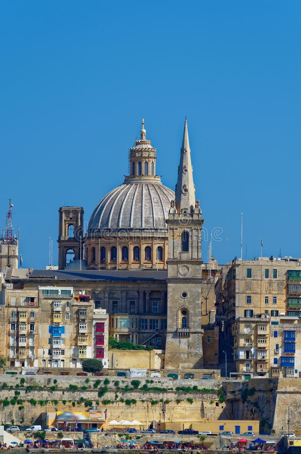 Basilica of Our Lady of Mount Carmel, Valletta. Basilica of Our Lady of Mount Carmel and St. Paul`s Pro-Cathedral in the foreground, Valletta, Malta royalty free stock photos