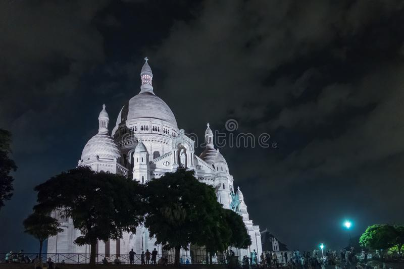 Basilica Sacre Coeur in Montmartre at night. Landscape format wi. Th copy space in sky stock photo