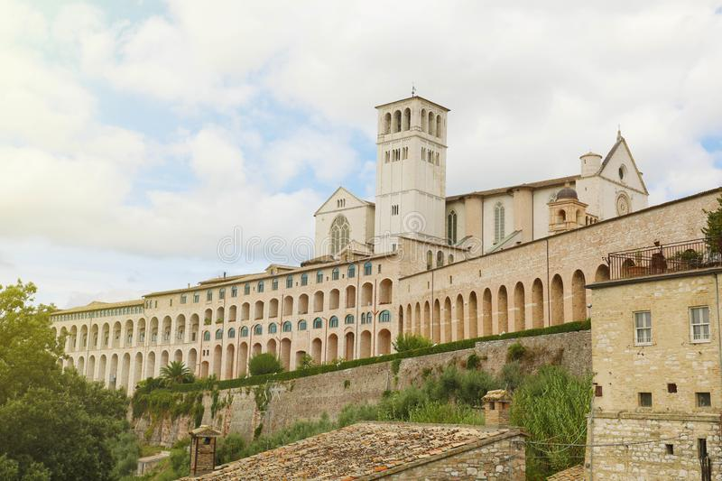 Basilica of Saint Francis of Assisi with Sacro Convento of Franciscan friary, Umbria, Italy.  stock photos