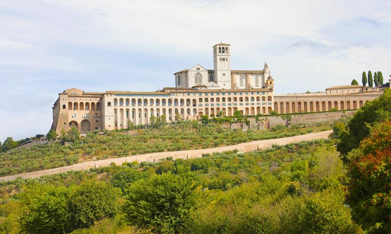 Basilica of Saint Francis of Assisi with Sacro Convento of Franciscan friary, Umbria, Italy.  stock photography