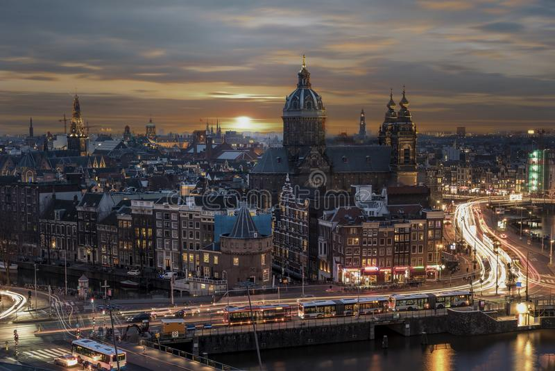Basilica Saint Nicolas. Sunset on the basilica Saint Nicolas church in Amsterdam sunset skyline with the traffic light trays, Netherlands stock photo