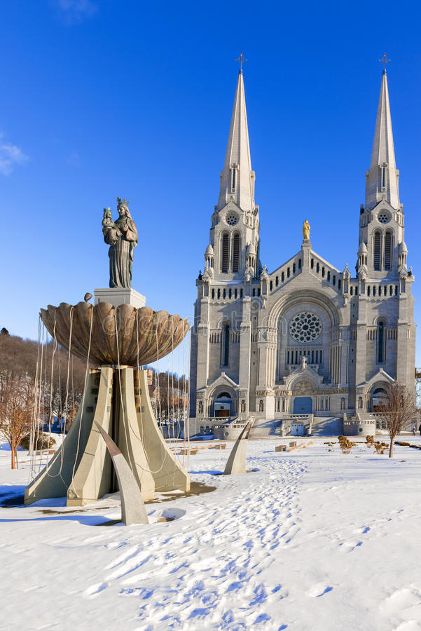 The Basilica of Sainte Anne de Beaupre in Quebec, Canada. The Basilica of Sainte Anne de Beaupre is a basilica set along the Saint Lawrence River in Quebec royalty free stock photo