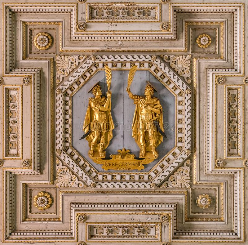 Detail from the ceiling of the Basilica of Saints John and Paul with the saints statues. Caelian Hill in Rome, Italy. The Basilica of Saints John and Paul on stock images