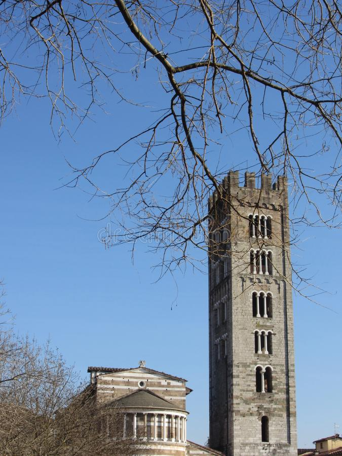 The Basilica of San Frediano and its bell tower . Romanesque church in Lucca, Italy stock photo