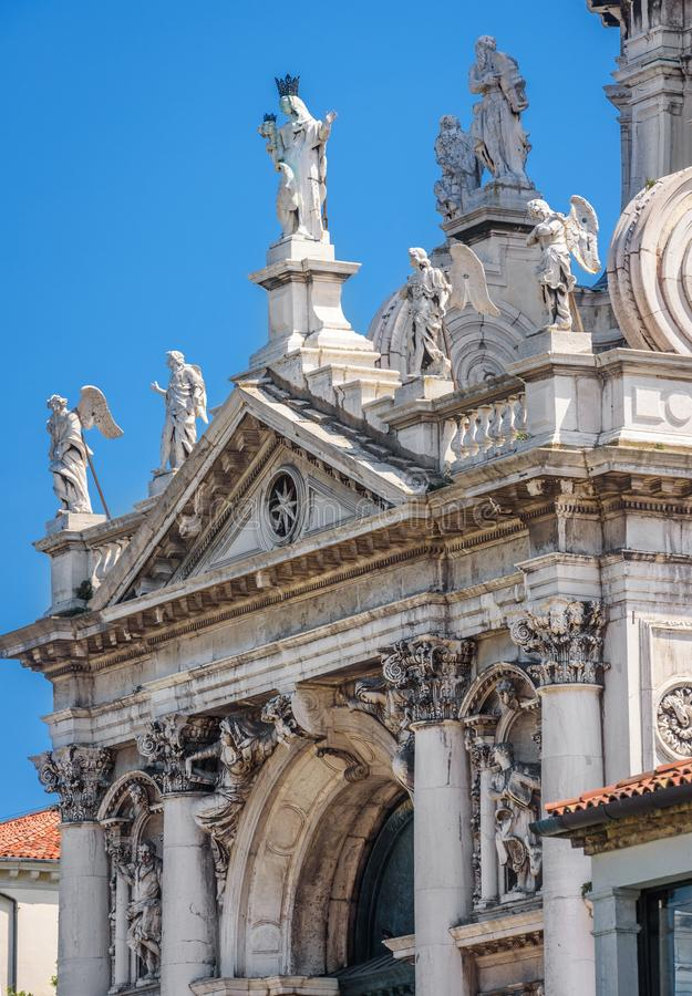Basilica of Santa Maria della Salute close-up in summer, Venice, Italy. The detail with statues on the facade. This church is one of the landmark of Venice royalty free stock photos