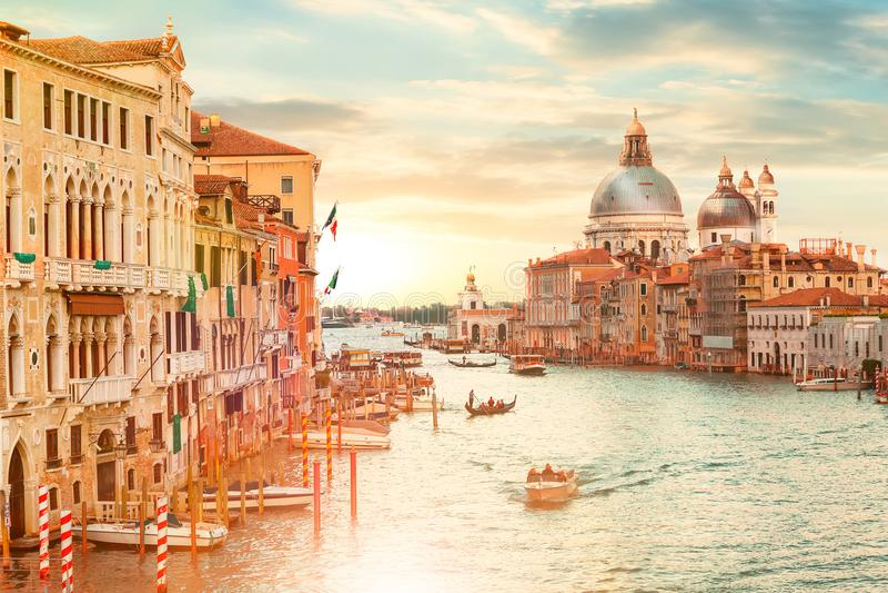 Basilica Santa Maria della Salute in Venice, Italy during beautiful summer day sunrise with vaporetto, gondolas. Famous venetian l. Andmark. Venice postcard stock images
