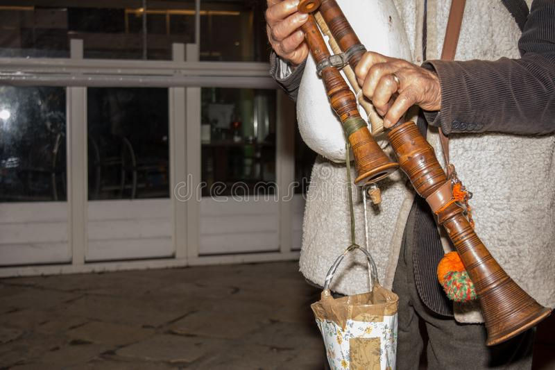 Basilicata Shepherd who Plays the Bagpipe during the Christmas Season. On Blurred Background royalty free stock photos