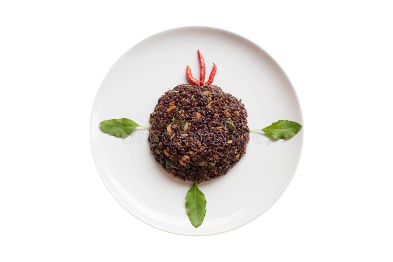 Basilika stekte riceberry ris blandade med finhackat griskött royaltyfria foton