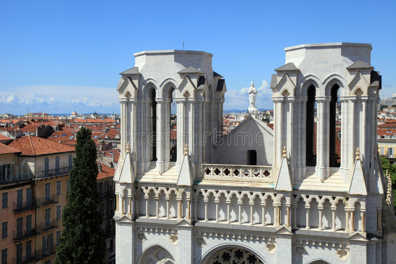 Basilique Notre Dame de Nice and red tile roofs in the centre of. Basilique Notre Dame de Nice and red tile roofs of old houses, Nice, France. View from above royalty free stock photography