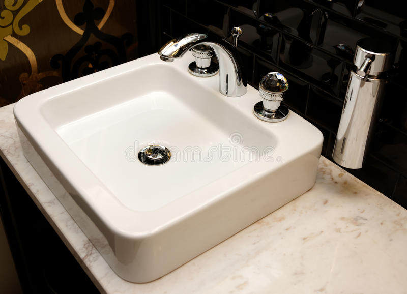 Basin in a restaurant toilet royalty free stock photo