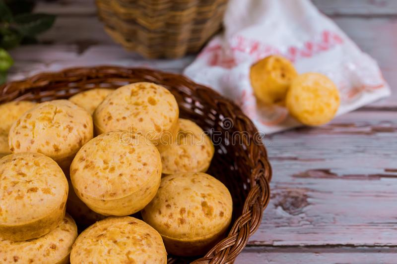 Basket with argentin cheese bread, chipa. On white wooden background, ecuador, gerais, paraguay, food, lunch, cuisine, gourmet, meal, minas, table, dinner stock photography