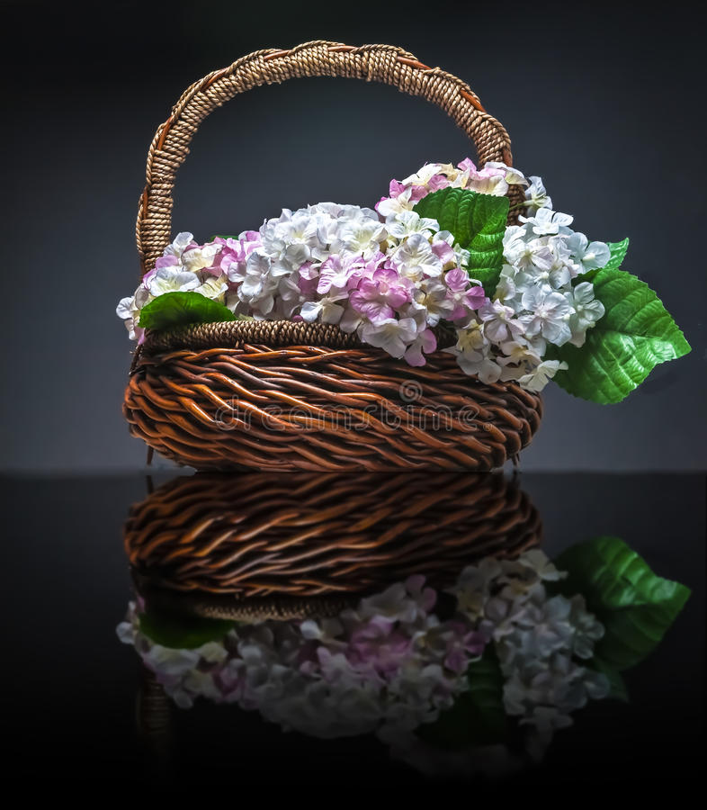 Download Basket Of Artificial Flowers Against Dark Background Stock Photo - Image of vase, bouquet: 49763722