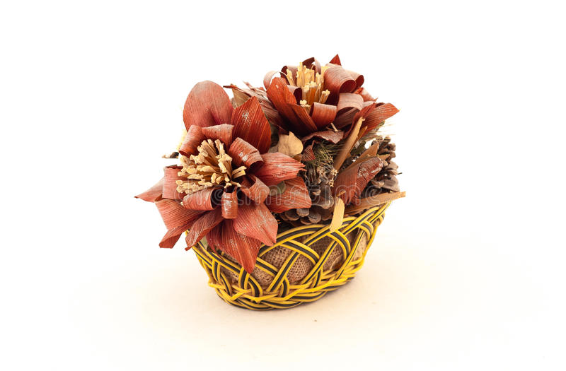 Basket with artificial flowers stock images