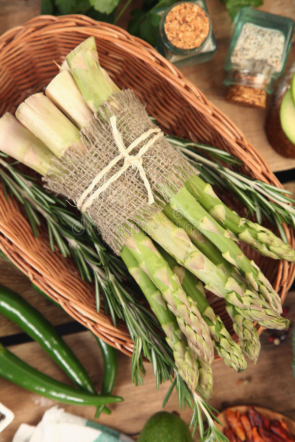 Basket with asparagus stock image