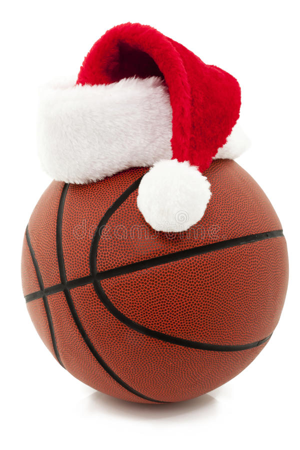 Basket-ball avec le chapeau de Santa photos stock