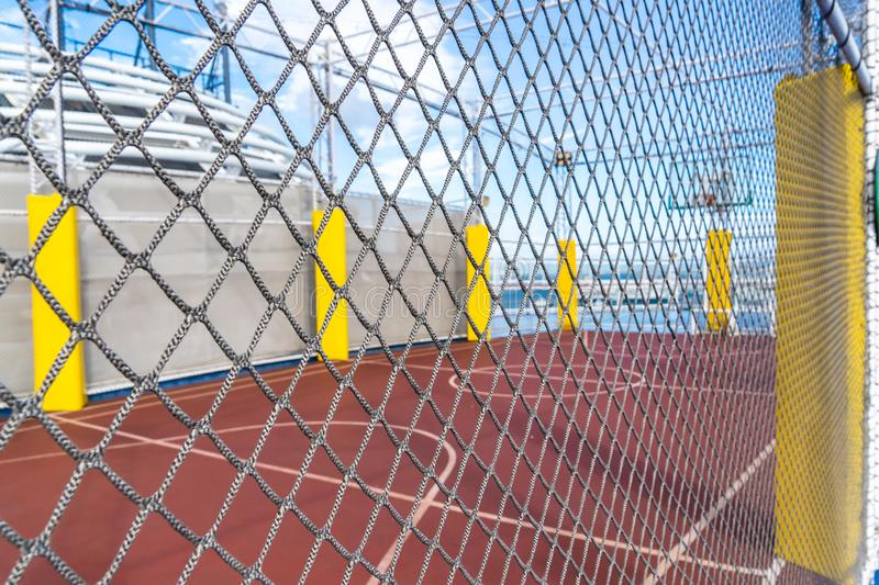 Basket Ball court with mesh protection with blue background for street city sport active concept background and backdrop royalty free stock photo