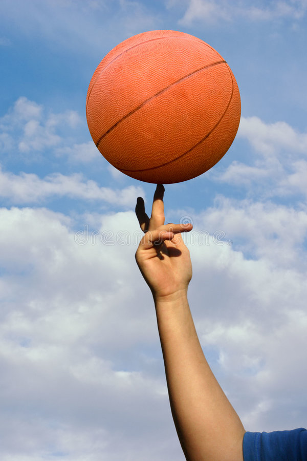 Download Basket-ball de rotation photo stock. Image du doigts, bleu - 738290