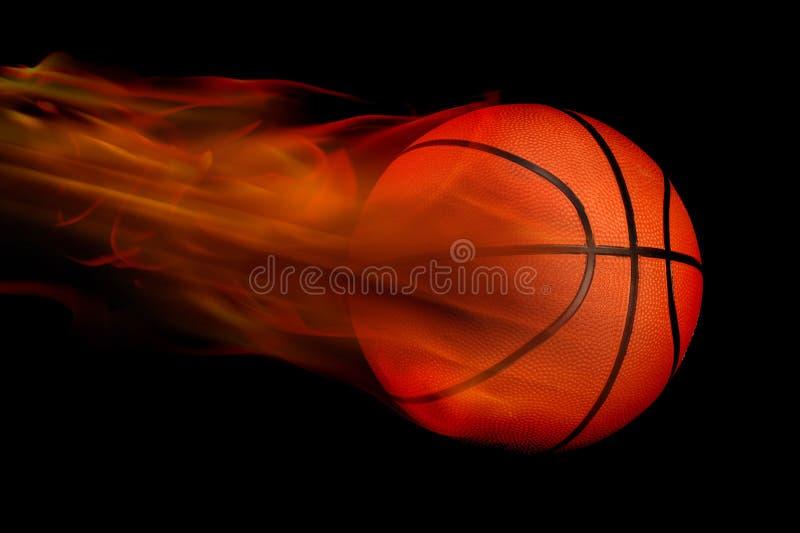 Basket-ball flamboyant sur le noir illustration stock