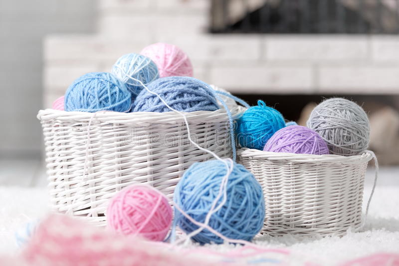 Basket with balls of yarn royalty free stock photography