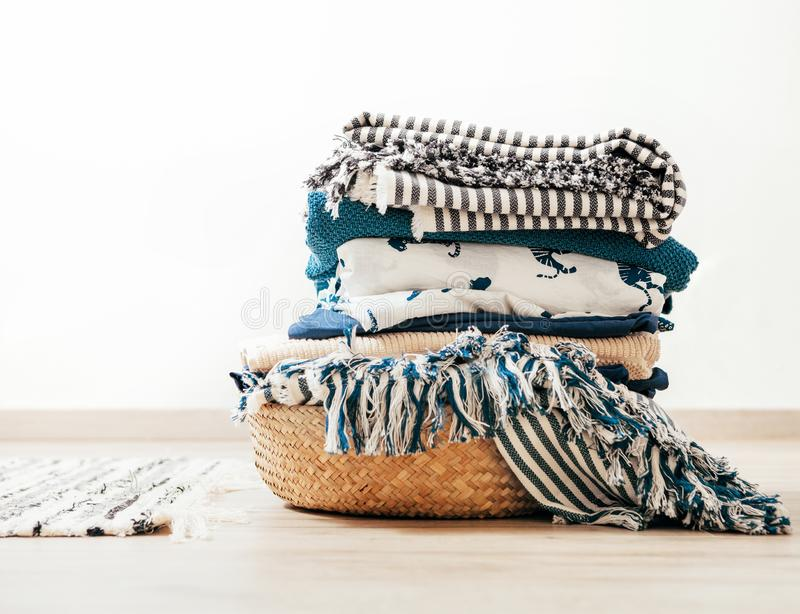 Basket with blue and beige laundry stock photos