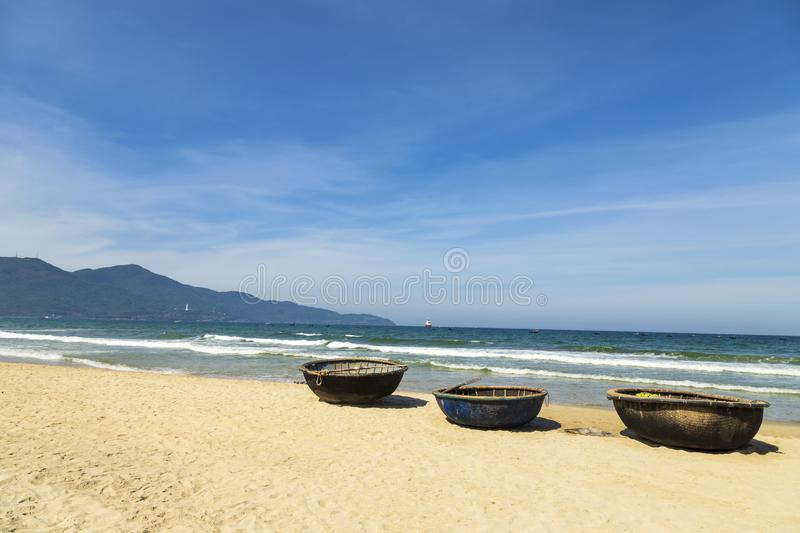 Basket boats on My Khe beach in Danang. Traditional Vietnamese small fishing boats on My Khe Beach in Danang, Vietnam royalty free stock photography
