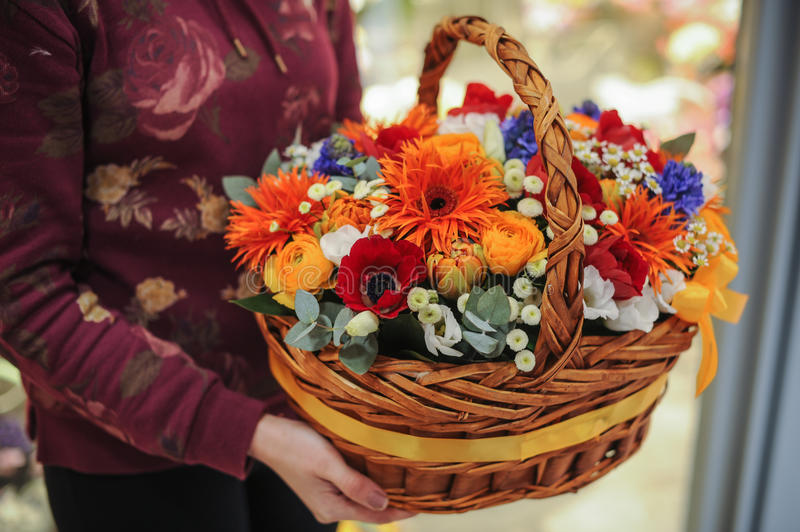 Basket with a bouquet of colorful flowers royalty free stock photo