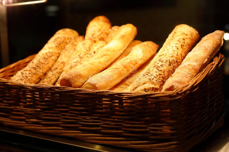Basket with bread sticks on bakery counter. Selective focus stock photo