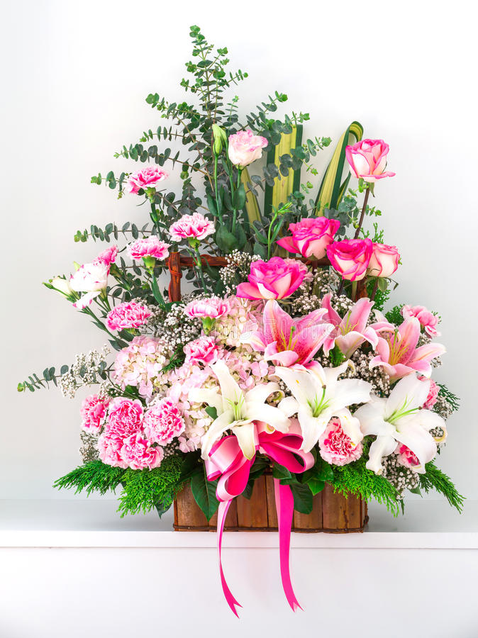 Basket of Carnation lily and rose royalty free stock photos