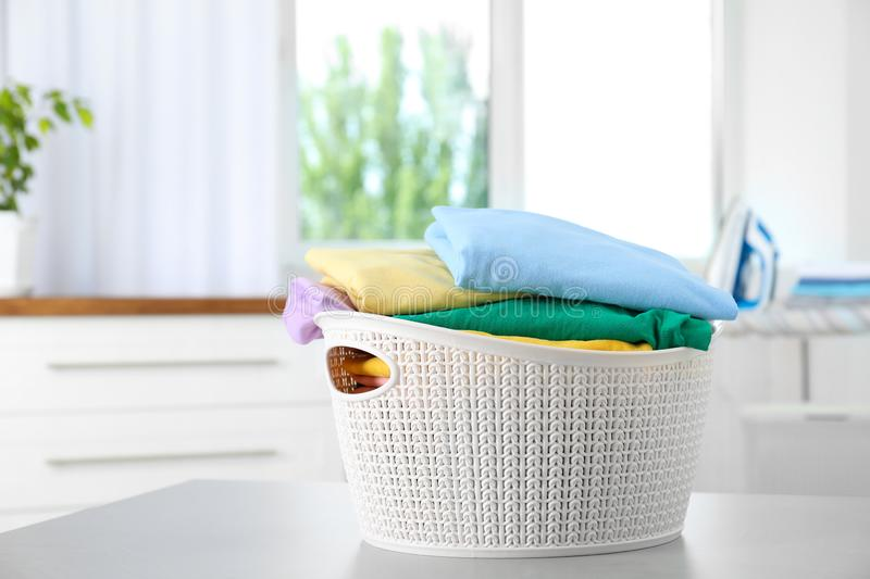 Basket with clean laundry on table at home stock images
