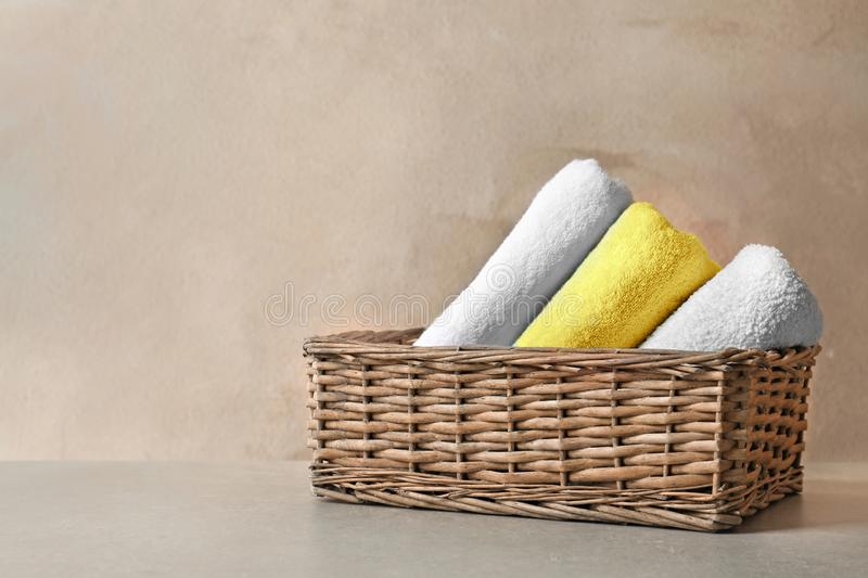 Basket with clean towels stock image