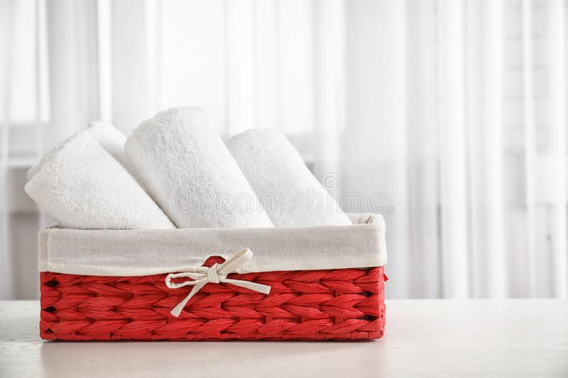 Basket with clean towels royalty free stock photography