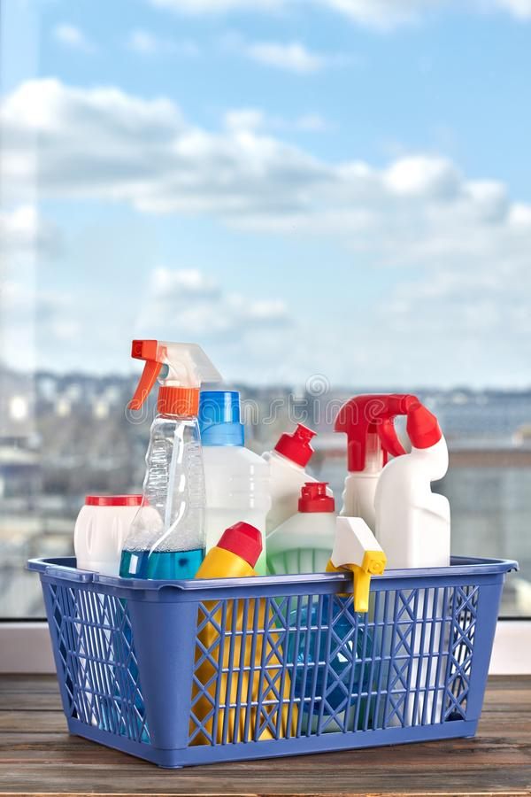 Basket with cleaning supplies. royalty free stock image