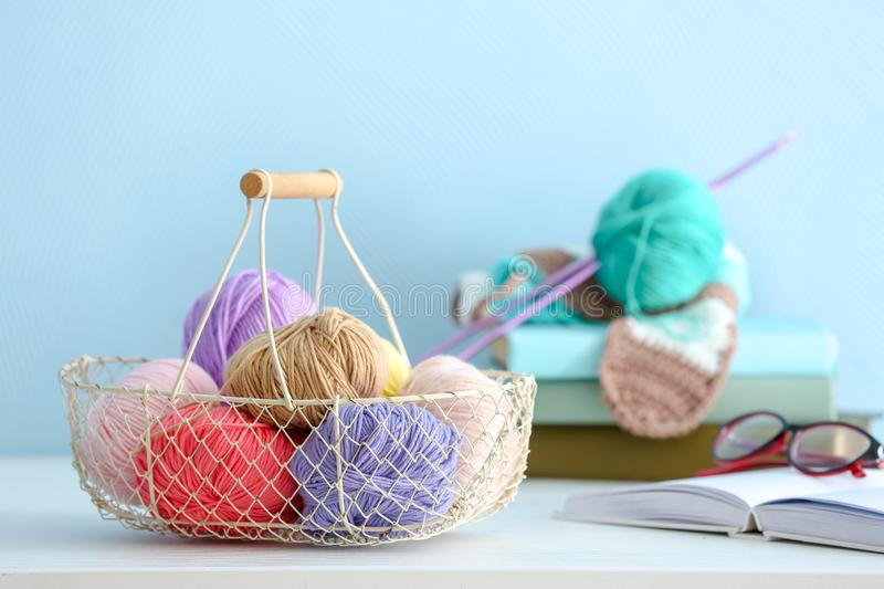 Basket with colorful knitting yarns on table indoors royalty free stock photos