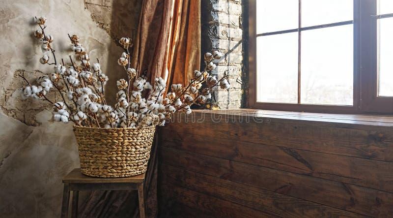 , , , Basket, cotton branches, loft interior, brick wall stock photography
