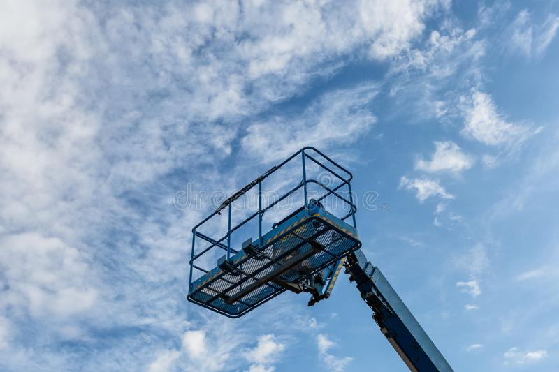 The basket crane and cloudy sky stock photography