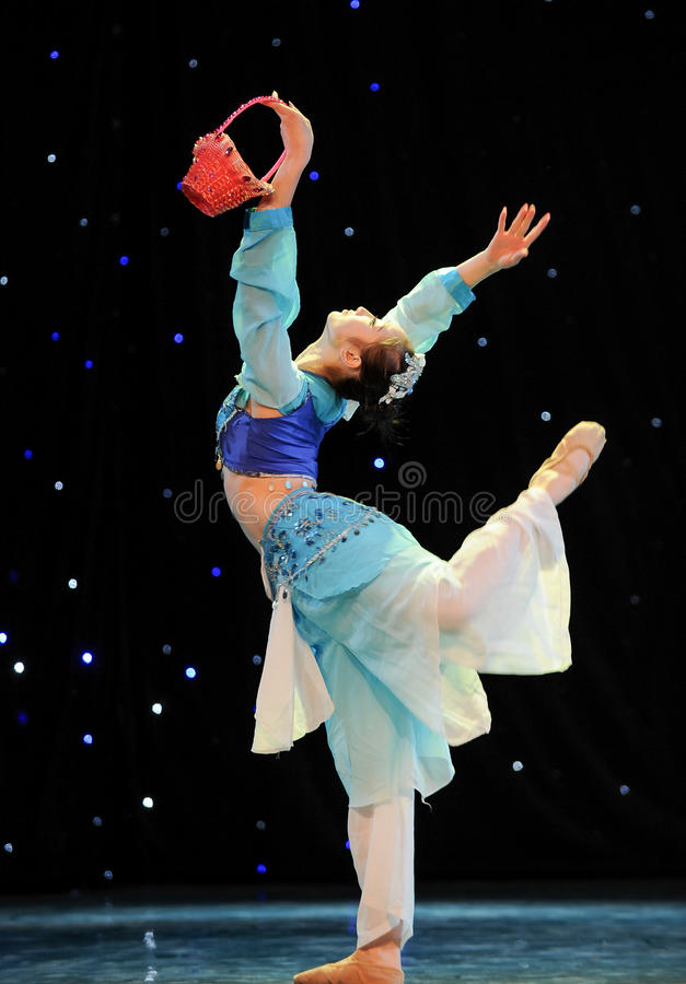 Basket dance. This is a chinese folk dance which will be performed during harvest season。The Chinese people have many kinds of folk dances which can mean stock images
