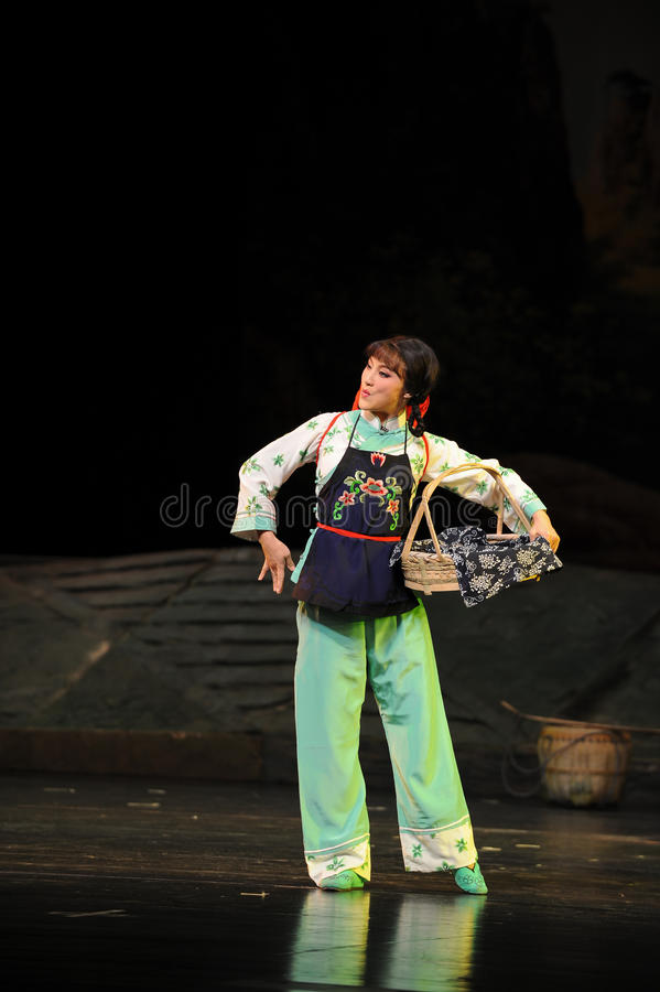Basket dance- Jiangxi opera a steelyard. Jiangxi opera a steelyard is adapted from a true story: the last century fortys, the protagonists father runs an oil royalty free stock photos
